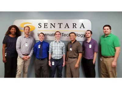Sentara's Junior Cyber Security Analysts hired through CSIIP and their mentors are all smiles for this photo opportunity!